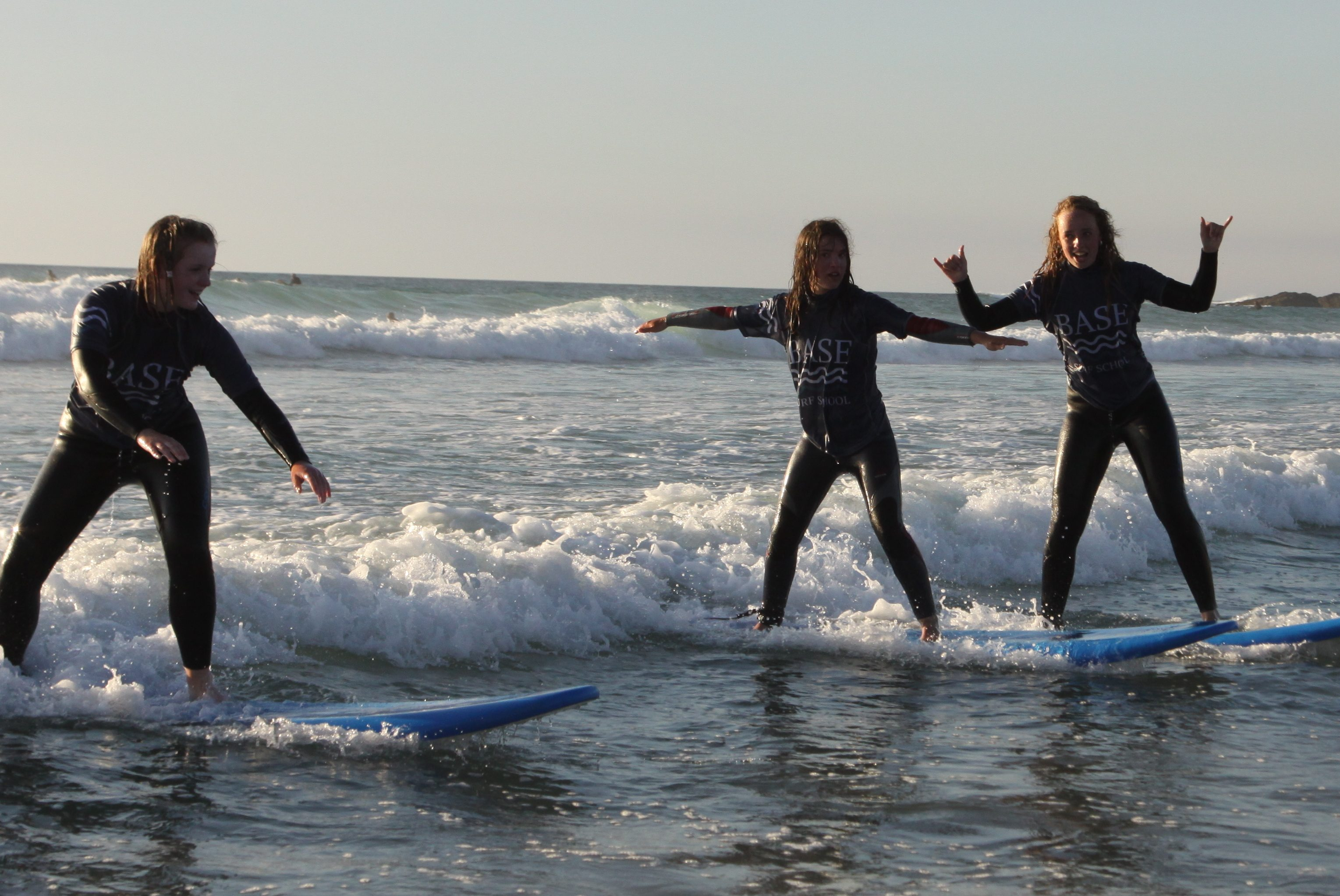 surfing girls at sunset