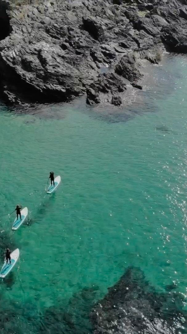 "Stand-up Paddleboarding. For our first episode of ""Step Out the Front Door "" we headed to the Gannel estuary on the Pentire side of Newquay. We caught up with our friends @biggreensurf who offer hire and guided paddleboard tours.   We were out on crystal clear water just after first light and spent a beautiful morning paddling the caves, gullies and coves that run along Pentire.  @pictureorganicclothing  @sandbanksstyle  @kt_stewo  @samford12   #sup #standuppaddleboarding  #standuppaddle  #supuk  #crantock  #thegannel  #pentire  #coasteering  #stepoutside #paradise #adventuretravel"